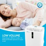 Mother and baby enjoy resting with the comfort of cool temperatures and low volume from their portable AC unit RolliCool